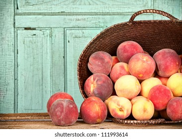 Many peaches spilling out of a basket