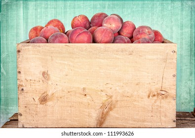 Many peaches in wooden crate with antique panel background