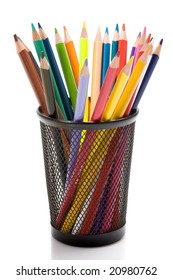 Many pencils of different colors on a over white background