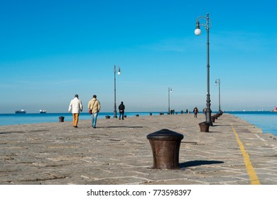 many people have walk at famous Audace Pier in Trieste city, Italy
