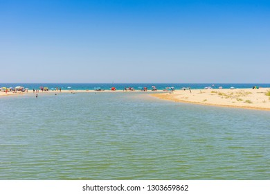 Many people relaxing on Salgados Beach between Albufeira and Armacao de Pera, Algarve, Portugal