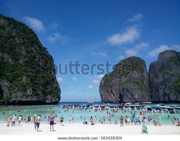 Many people and speed boats at Maya bay, Phi Phi Island, Krabi, Thailand on 4th February 2017
