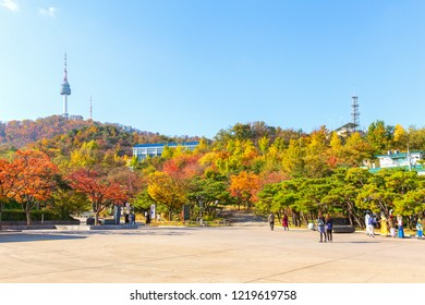 Many people visit and tour at Namsangol Hannok Village and Seoul Tower Located on Namsan Mountain in Autumn season at Seoul,South Korea.