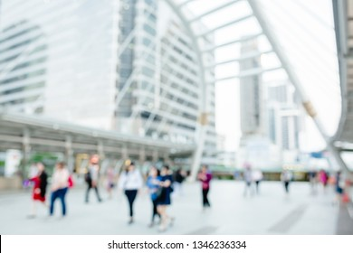 many people walking on the skywalk with blurry image, lifestyle in city, the concept of a hasty life, Sathorn Bangkok Thailand