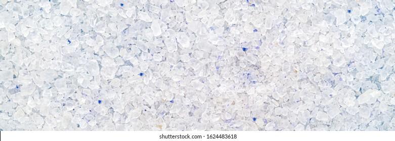 Many Persian blue rock salt crystals background, close up. Blue Persian  salt, close up macro, banner