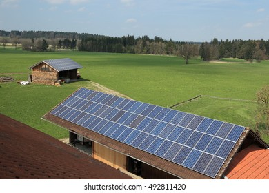 many photovoltaic cells on different roof tops