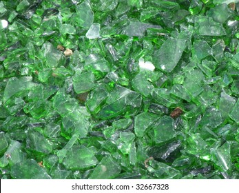 many pieces of broken glass in green