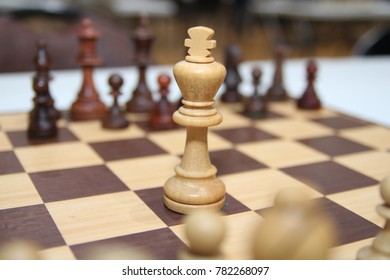 Many pieces on chess game board. Strategy concept.