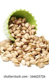 Many pistachio on white background