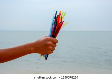 Many plastic straws garbage collected from beach area. Say no to single use plastic. Environmental/pollution concept.
