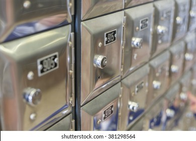 Many po boxes at the post office. The mail boxes are lined up in rows and columns. Selective focus