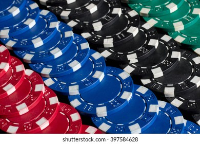 Many poker chips. Many old poker chips. Many color poker chips background, closeup. Background created with casino chips. Fortune, game and entertainment concept - close up of casino chips background.