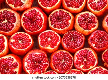 many pomegranate  cut in half, pomegranate background
