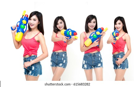 Many poses of girl holding a water gun and happy playing. On Songkran Festival Day, isolated on white studio background.