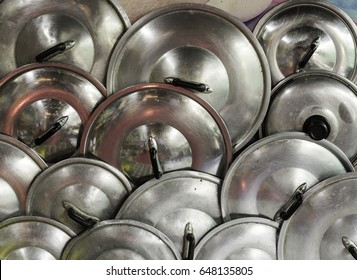 Many pot lid hanging after Cleaned
