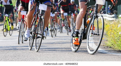 many racing bikes led by trained cyclists during the street race