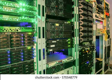 Many racks with servers located in the server room. Bright display a plurality of operating equipment.
