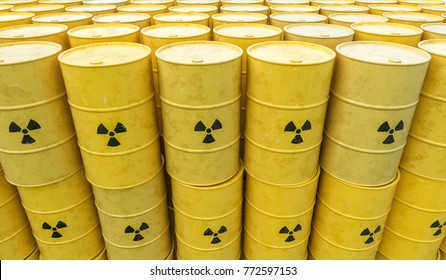 Many radioactive waste barrels. Nuclear waste dumping concept. 3D rendered illustration.
