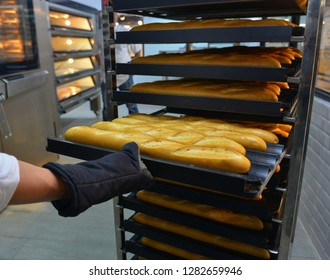 Many ready-made fresh bread in a bakery oven in a bakery.
