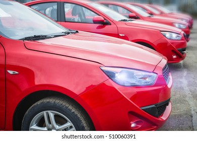 many red car with a small depth of field