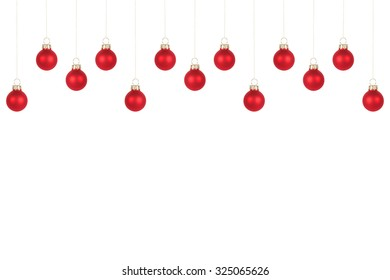 Many red Christmas tree balls, isolated on white background, copy space at the lower part of the image