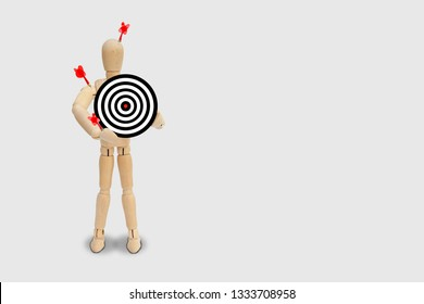 Many red darts missed hit target on dartboard isolated on gray background.