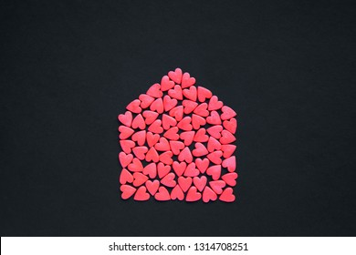 Many red hearts in the form of house. House full of love concept.