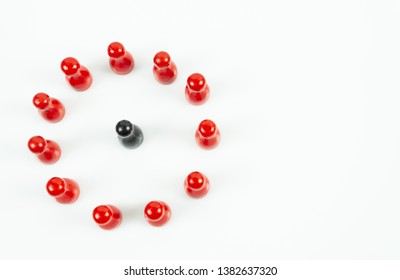 Many red meeple in a circle and one black meeple in the middle, white background, top view and copy space