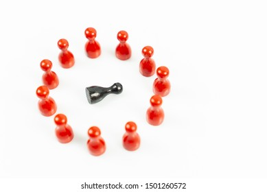 Many red meeple in a circle and one black meeple falling down in the middle, white background, top view and copy space