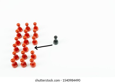 Many red meeple in a row and a black meeple leaving the red ones, white background and copy space