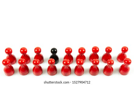Many red meeple in a row and one black meeple, white background and copy space