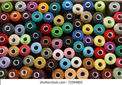 many reels of threads for embroidery, colorful, background