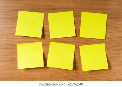 Many reminder notes on the wooden background