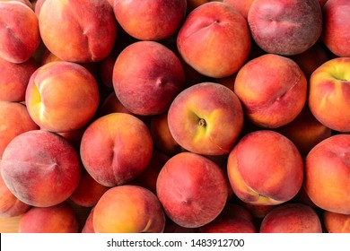 Many ripe peaches as background