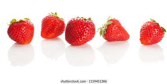 Many ripe red strawberries on white background