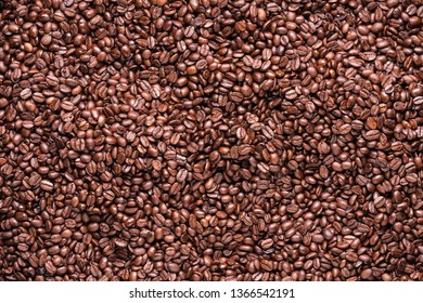 Many roasted coffee beans in group.