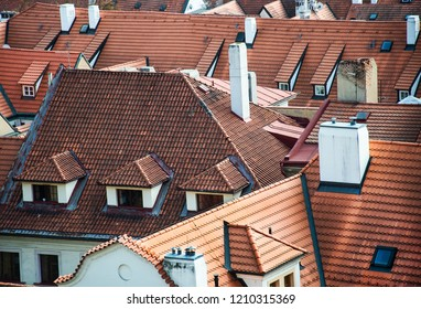 many roofs made of clay bricks fotographed from above in Prague - Czech Republic