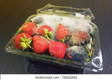 many Rotten bad fresh strawberry fruit inside a plastic carry box