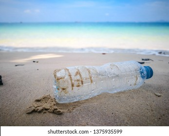 Many rubbish on the beach with backdrop are blurred blue sky and horizon