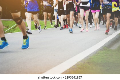 Many runners run for health on the city road