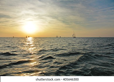 Many sailing boats on the sea with sun reflection in the sea