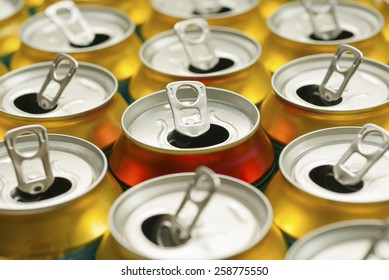 many same and one different opened beer can