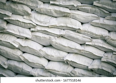 Many sandbags are used to strengthen the shore, clutter structures. Protective wall of sandbags. Piled sandbags for protection against natural disasters, texture.