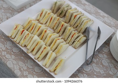 many sandwich on white dish