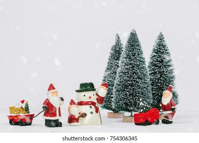 Many Santa Claus prepare decoration for Cristmas holiday festival. Christmas holiday celebration concept.