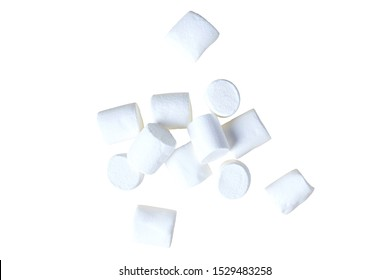Many scattered pieces of raw sweet tasty marshmallows cylindrical form isolated on white background. Close-up. Top view
