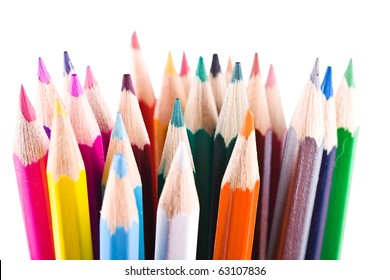 Many sharp color pencils over white