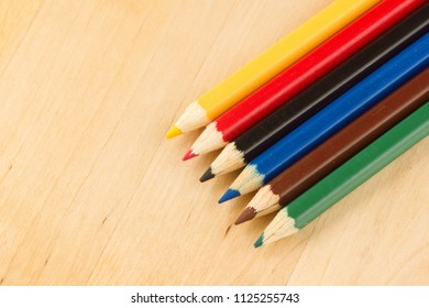 many sharp sharpened colored pencils close-up on the background