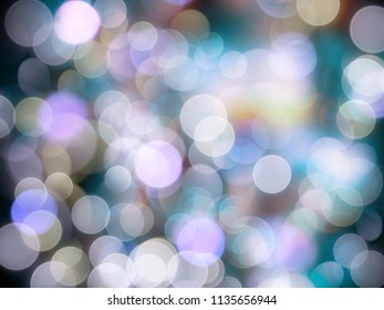 Many shining blurred bright twinkling lights in varied pale colours and a dark background