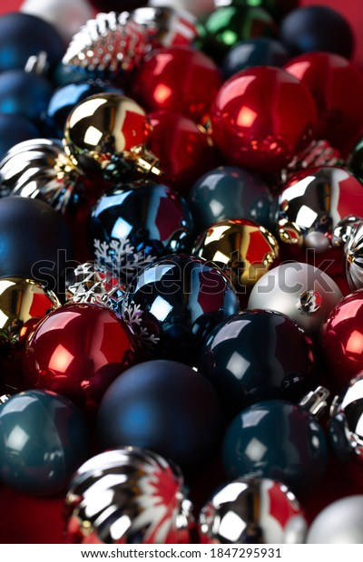 Many shiny christmas baubles on red background. SHallow depth of field, selective focus